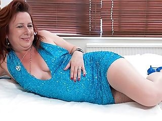 Crimson Matures Whore Playing On Her Couch